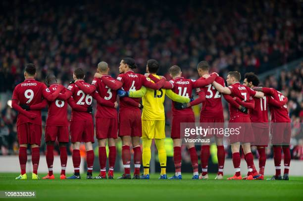 The Liverpool team during a minutes silence before the Premier League match between Liverpool FC and Crystal Palace at Anfield on January 19 2019 in...