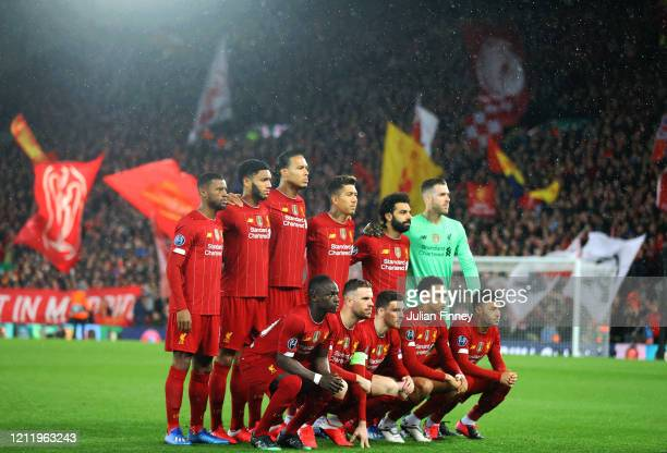 The Liverpool team line up before the UEFA Champions League round of 16 second leg match between Liverpool FC and Atletico Madrid at Anfield on March...
