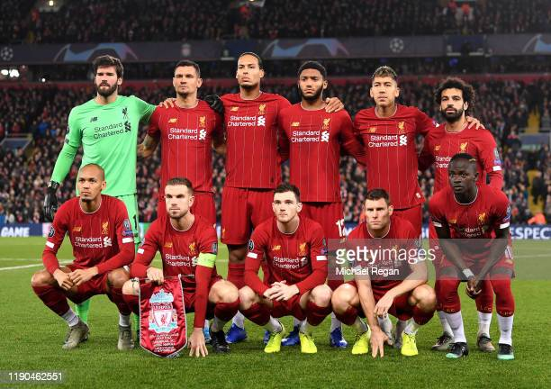 The Liverpool team line up for a photo prior to the UEFA Champions League group E match between Liverpool FC and SSC Napoli at Anfield on November 27...