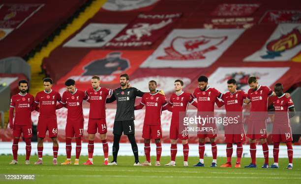 The Liverpool team line up to observe a moment of silence in advance of Remembrance Day before kick off of the English Premier League football match...
