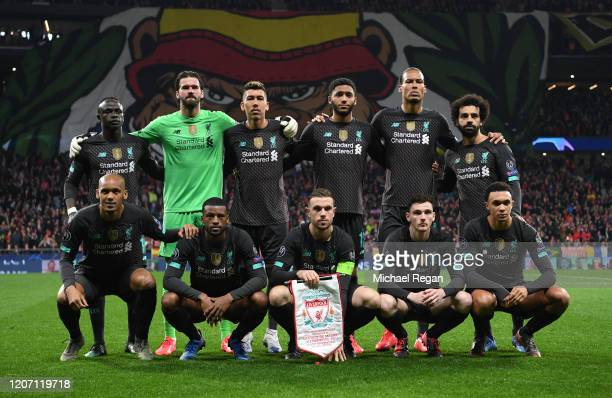 The Liverpool team pose for a team photo prior to the UEFA Champions League round of 16 first leg match between Atletico Madrid and Liverpool FC at...