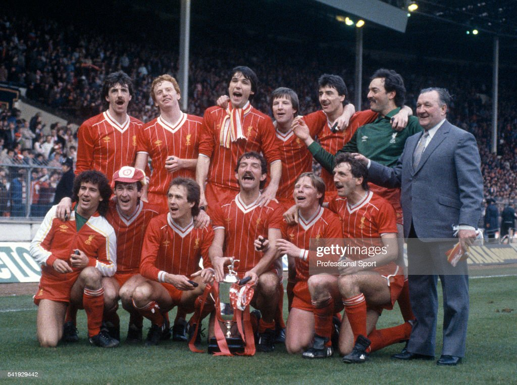 The Liverpool team posing with the trophy after their victory over Manchester United in the League Cup Final, sponsored by the Milk Marketing Board, at Wembley Stadium in London, 26th March 1983. Back Row (left-right) Mark Lawrenson, David Fairclough, Alan Hansen, Ronnie Whelan, Ian Rush, Bruce Grobbelaar, and Bob Paisley (Manager), Front Row L-R: Craig Johnston, Kenny Dalglish, Phil Neal, Graeme Souness, Sammy Lee, and Alan Kennedy.