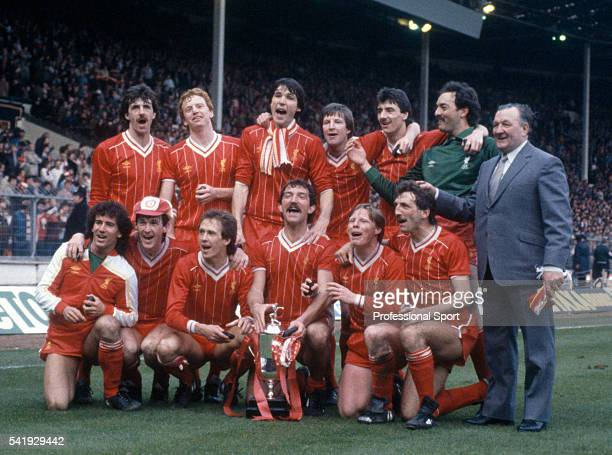 The Liverpool team posing with the trophy after their victory over Manchester United in the League Cup Final sponsored by the Milk Marketing Board at...