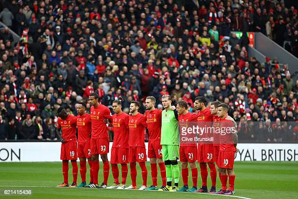The Liverpool team take part in a minutes silence in honour of Remembrance Day prior to the Premier League match between Liverpool and Watford at...