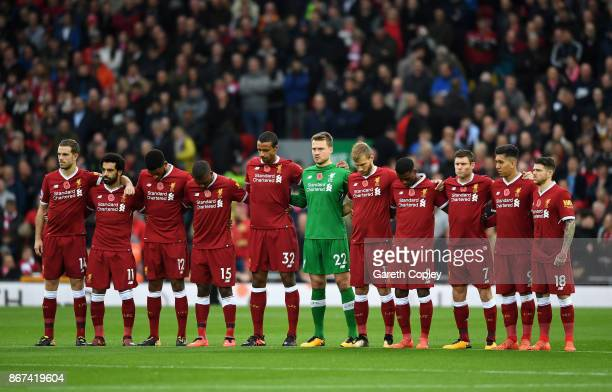 The Liverpool team take part in minute of silence for remembrance day prior to the Premier League match between Liverpool and Huddersfield Town at...