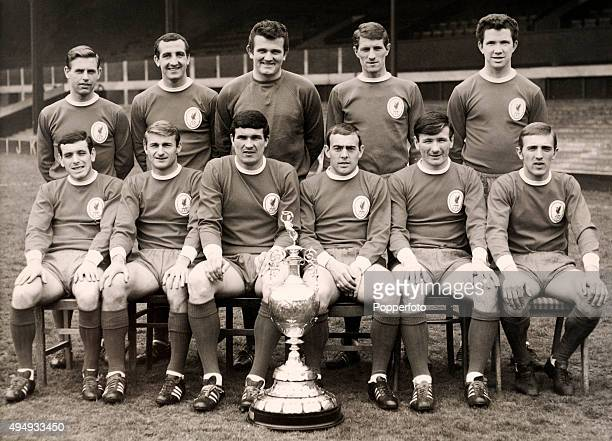 The Liverpool team with the 1st Division Championship trophy circa August 1966 Back row left to right Gordon Milne Gerry Byrne Tommy Lawrence Geoff...