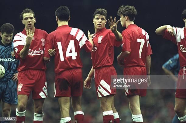 The Liverpool wall Rob Jones Mike Marsh Stig Bjornebye Steve McManaman and Jamie Redknapp during an FA Carling Premier League match against...