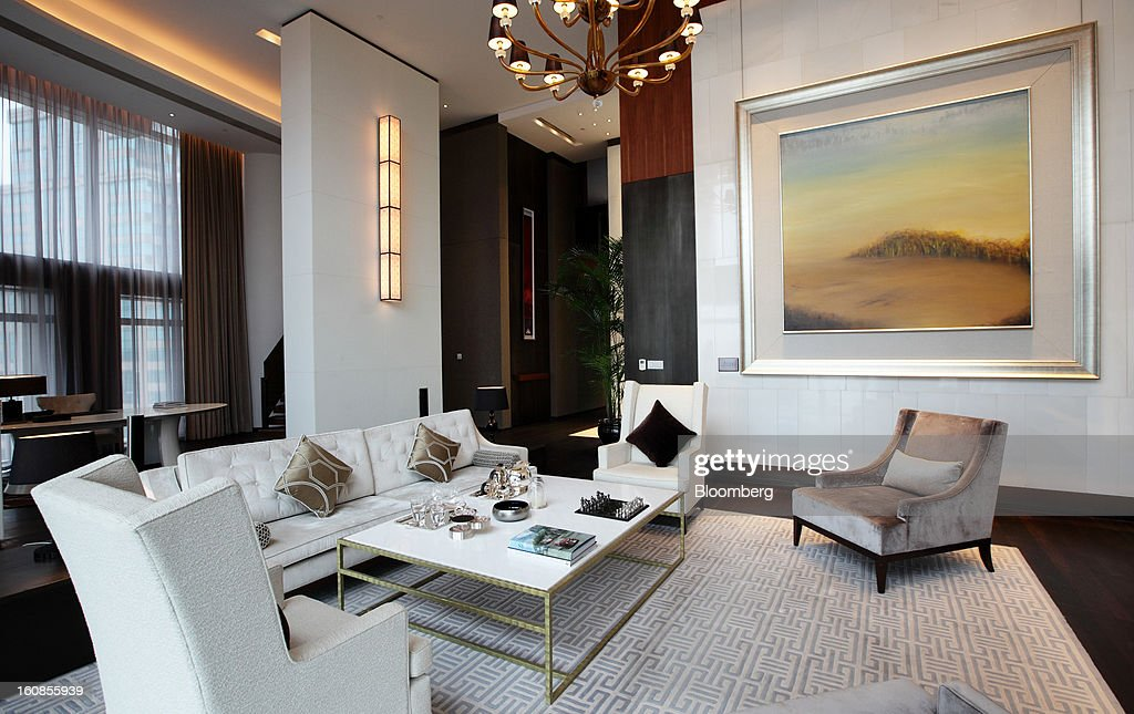 The living area of the chairman's suite at the Langham Xintiandi hotel, developed by Shui On Land Ltd., is seen in Shanghai, China, on Wednesday, Feb. 6, 2013. China's economic growth accelerated for the first time in two years as government efforts to revive demand drove a rebound in industrial output, retail sales and the housing market. Photographer: Tomohiro Ohsumi/Bloomberg via Getty Images