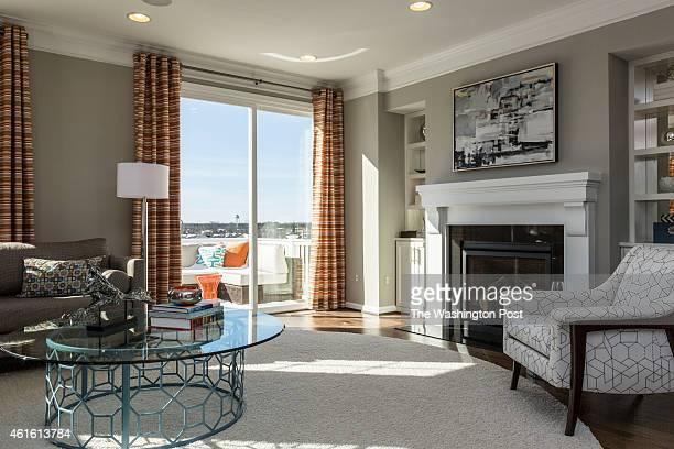 The Living Area with View of Back Deck in the Verde Model at the Meridian Collection of Townhomes at Victory Lakes on January 8 2015 in Bristow...