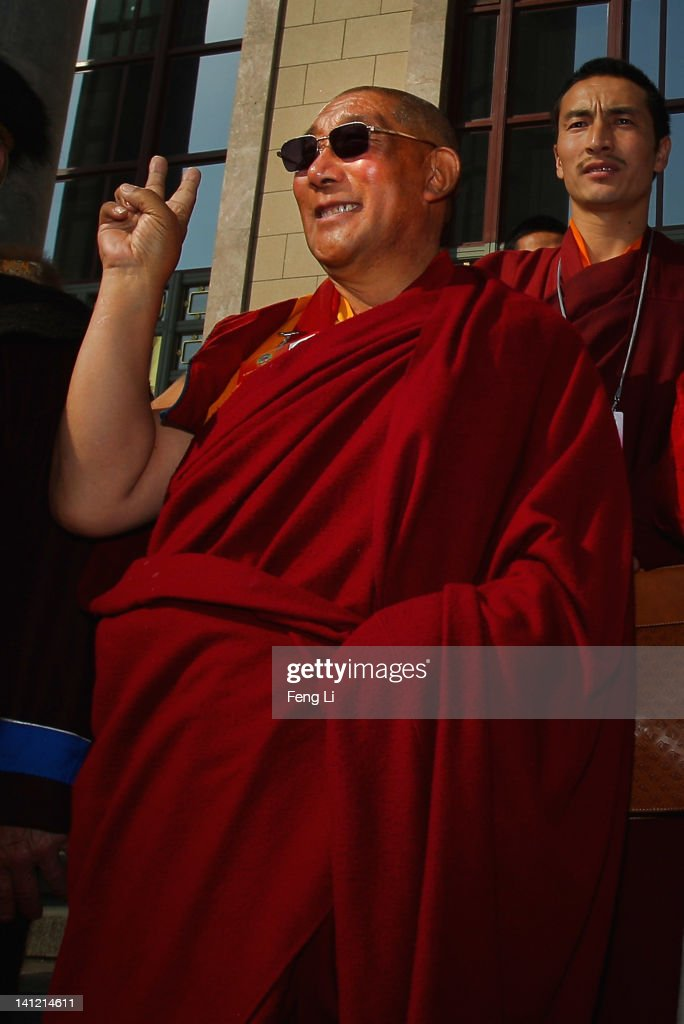 The living Buddha of Tibet poses as he leaves the closing ceremony of the Chinese People's Political Consultative Conference (CPPCC) at the Great Hall of the People on March 13, 2012 in Beijing, China. Known as 'liang hui,' or 'two organizations', it consists of meetings of China's legislature, the National People's Congress (NPC), and its advisory auxiliary, the Chinese People's Political Consultative Conference (CPPCC).