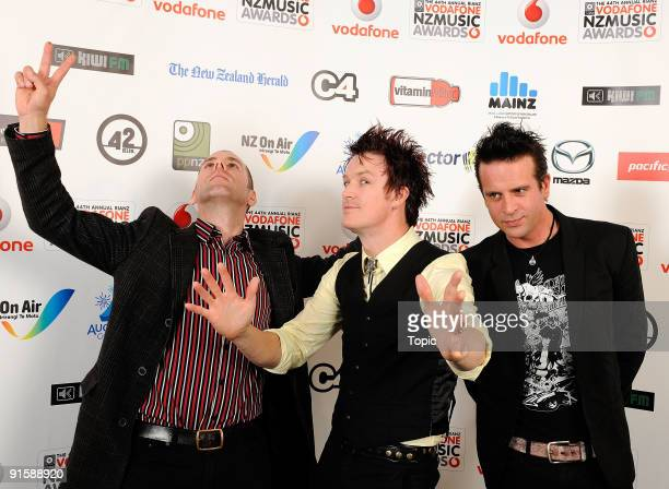 The Living End pose during the 2009 Vodafone Music Awards at Vector Arena on October 8 2009 in Auckland New Zealand