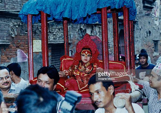 The living goddess of Nepal called Kumari Devi and worshiped by both Hindus and Buddhists is carried through the streets of Kathmandu during the...