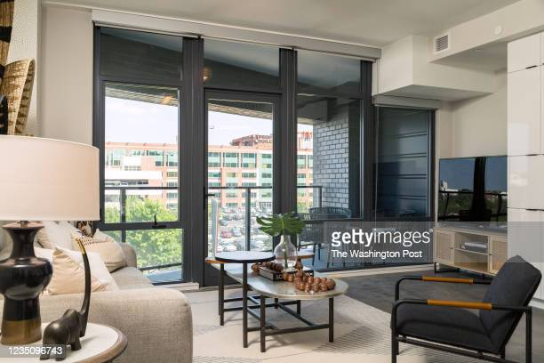 The Living Room and Patio in the model condominium at Tribeca on August 27, 2021 in Washington DC.