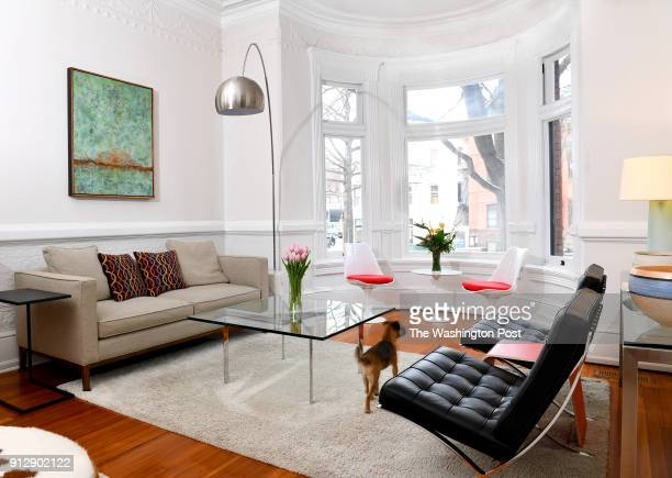 The living room of David Feinstein and Susan Pitman's renovated home still has chair rail molding and Victorian details January 04 2018 in Washington...