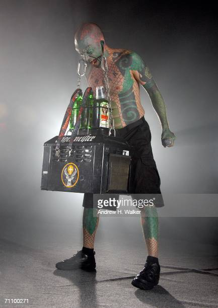 The Lizard Man lifts a Jagermeister Cooler using his earlobes during the Jagermeister Music Tour featuring Staind at the Nokia Theatre May 31 2006 in...