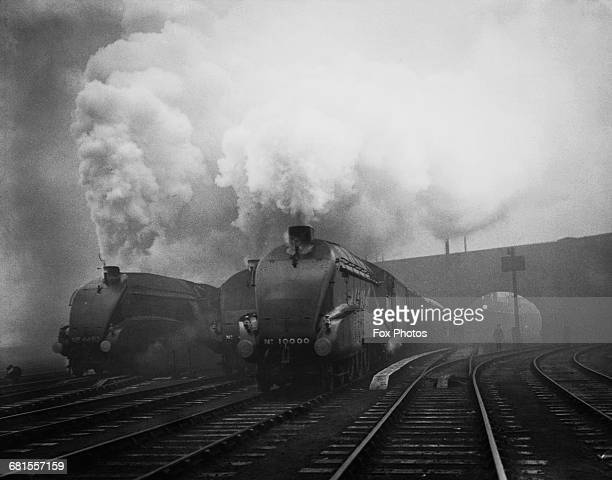 The LNER 464 Class W1 No10000 steam tender locomotive with A4style streamlining designed by Sir Nigel Gresley steams out of King's Cross station...
