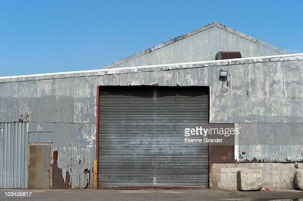 the loading dock of a warehouse - industrial door stock pictures, royalty-free photos & images