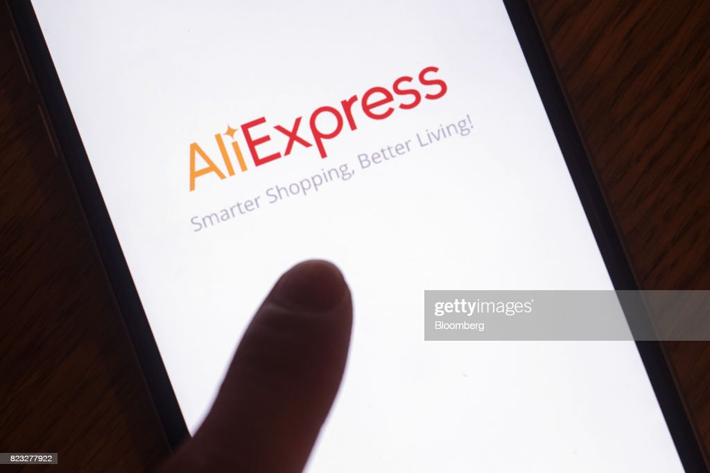 The loading page for Alibaba Group Holding Ltd.'s AliExpress application is displayed on an Apple Inc. iPhone in an arranged photograph taken in Hong Kong, China, on Wednesday, July 26, 2017. Alibaba is scheduled to release second-quarter earnings figures on Aug 10. Photographer: Anthony Kwan/Bloomberg via Getty Images