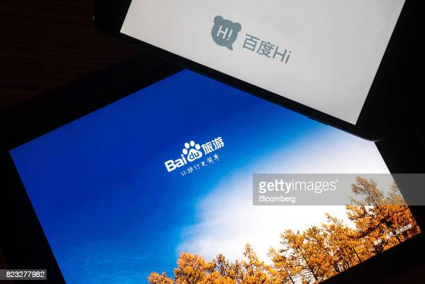 The loading page for Baidu Inc's travel bottom and Hi applications are displayed on Apple Inc iPad and iPhone in an arranged photograph taken in Hong...