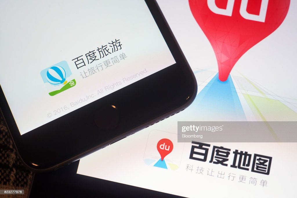 The loading pages for Baidu Inc.'s travel, left, and map applications are displayed on Apple Inc. iPad and iPhone in an arranged photograph taken in Hong Kong, China, on Wednesday, July 26, 2017. Baidu is scheduled to release second-quarter earnings figures on July 28. Photographer: Anthony Kwan/Bloomberg via Getty Images