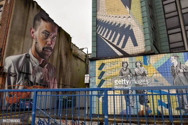 The Lobster Cook mural left and part of the Unite the Union mural right adorn buildings in Belfast Northern Ireland on Wednesday April 4 2018 Brexit...
