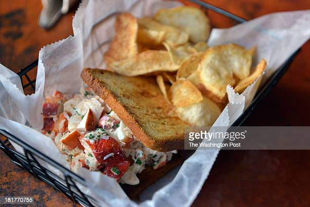 """The """"Lobster Roll"""" on buttered brioche with salt and vinegar chips at Bar Charlie on Thursday, September 19 in Washington, DC. The restaurant's menu..."""