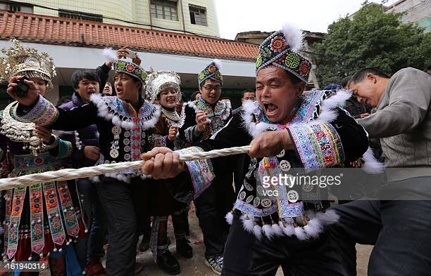 The local Miao nationality people wearing traditional clothes gather to celebrate the Spring Festival on February 17, 2013 in Rongshui, China. The...