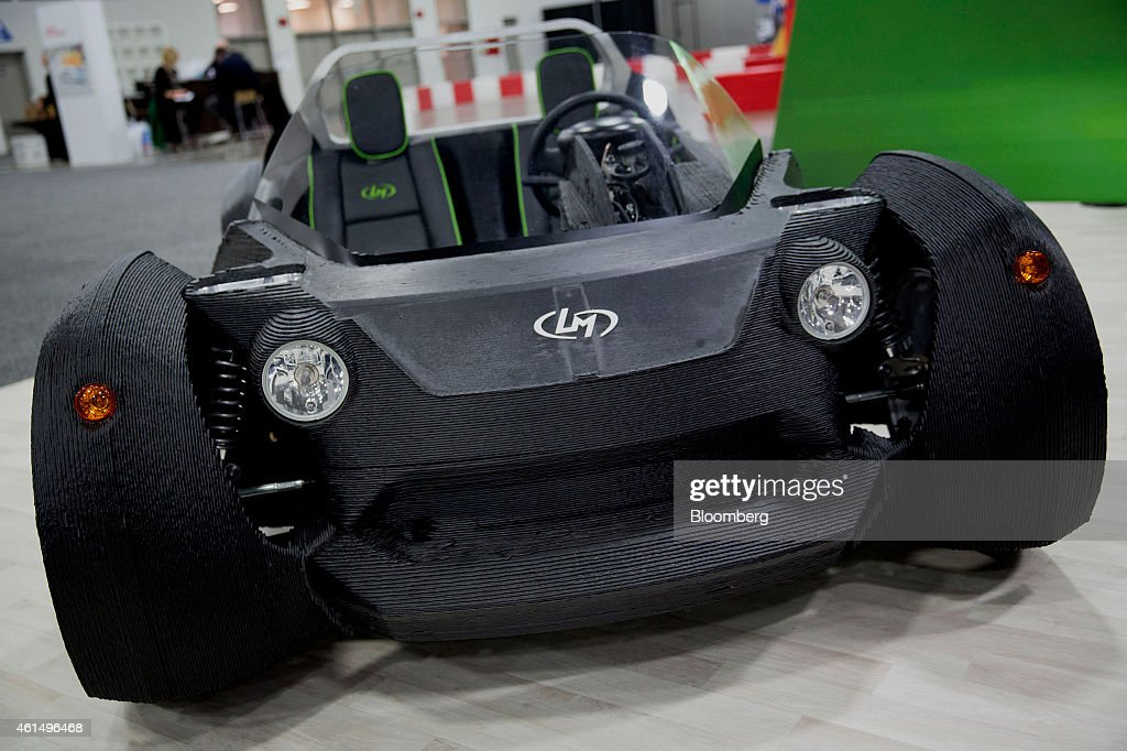 The Local Motors 3D-printed Strati vehicle sits on display during the 2015 North American International Auto Show (NAIAS) in Detroit, Michigan, U.S., on Tuesday, Jan. 13, 2015. NAIAS will reveal approximately 40-50 global and North American vehicles during the Jan. 12-13 press preview for the show. Photographer: Andrew Harrer/Bloomberg via Getty Images