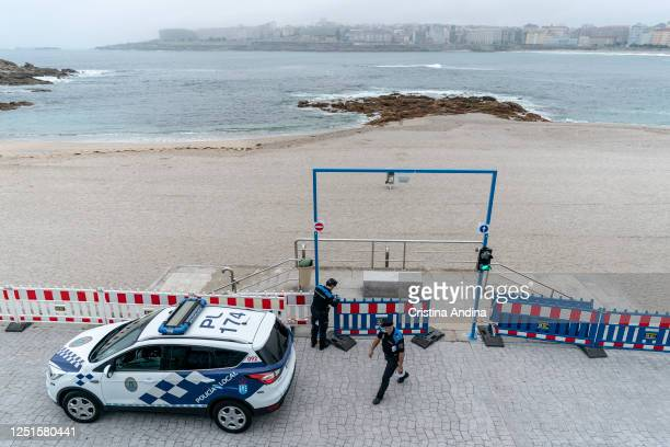 The local police cordon off access to Riazor beach on June 23 2020 in A Coruna Spain In A Coruña the night of San Juan is a celebration of...