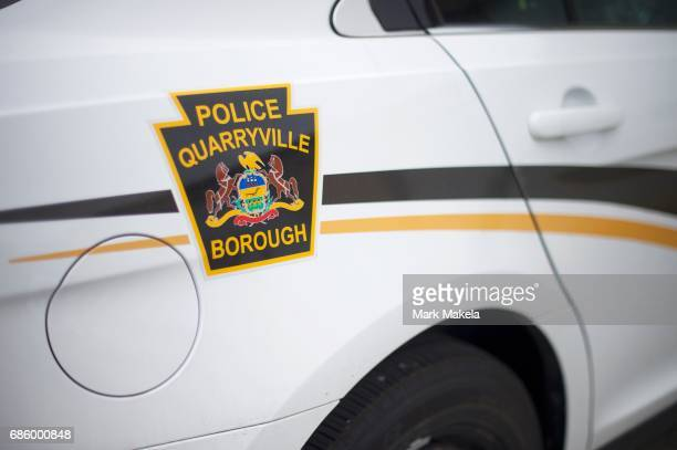 The local police force patrol car parks at the headquarters before a planned KKK rally May 20 2017 in Quarryville Pennsylvania A Marylandbased...