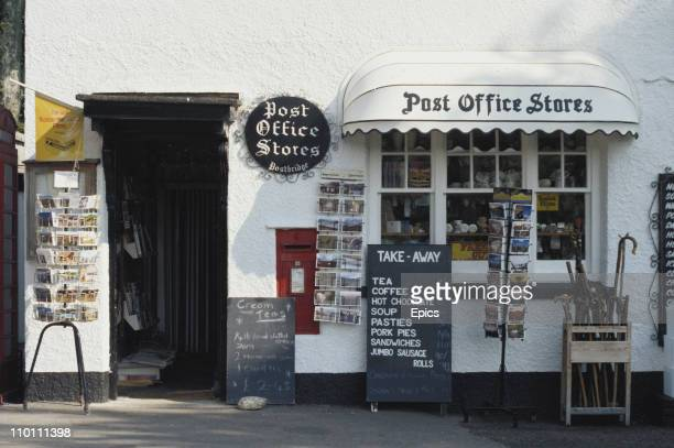 The local stores and post office offering cream teas and other beverages in the town of Chagford Devon England May 1997