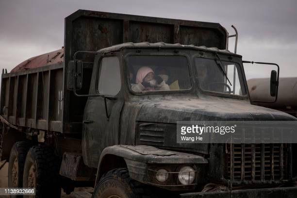 The local women by truck after planted trees in the desert at Mingqin county on March 27th 2019 in Wuwei Gansu Province China In order to prevent...