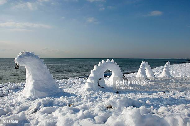 The Loch Ness Monster appears in snow form on Brighton Beach Brighton southern England on December 18 2009 Two London airports closed by heavy...