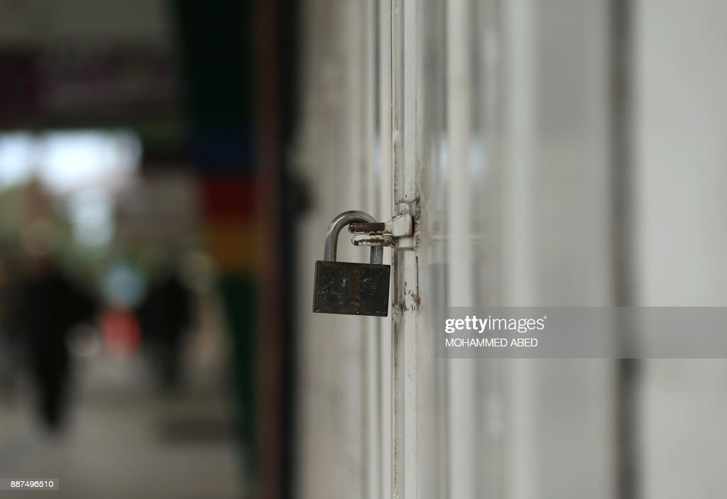 The locked door of a shop is seen in Gaza City as a general strike was called following US President Donald Trump's decision to recognise Jerusalem as the capital of Israel, on December 7, 2017. /