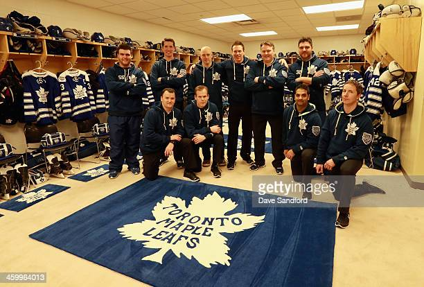 The locker room staff poses for a photo in the Toronto Maple Leafs locker room before the 2014 Bridgestone NHL Winter Classic on January 1 2014 at...