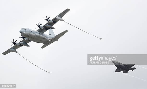 The Lockheed C130 Hercules and a The Lockheed Martin F35B take part in a flying display at the Farnborough Airshow south west of London on July 12...