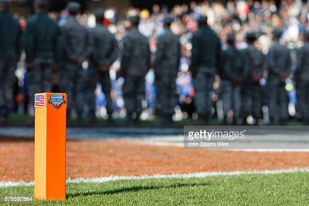 The Lockheed Martin Armed Forces Bowl logo is shown on an end zone pylon with soldiers in the back ground during the game between the California...