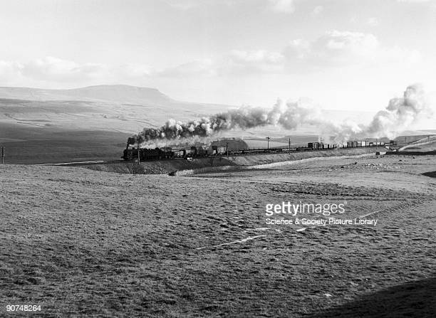 The locomotive is seen here passing PenyGhent near HortoninRibblesdale North Yorkshire on the Settle to Carlisle line Photograph by Eric Treacy...