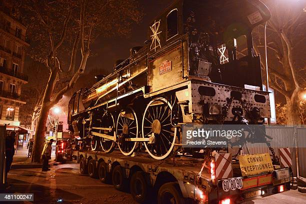 The locomotive train 'l'Orient Express' travels through Paris on March 27 2014 in Paris France The train is on it's way to the Institut du Monde...