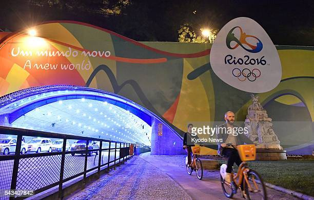 The logo and slogan of the Rio de Janeiro Olympic and Paralympic Games are featured at the entrance of a tunnel connecting the Rio de Janeiro city...