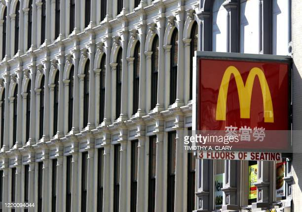 The logo for a McDonald's restaurant with Chinese characters is pictured 26 April 2005 on Canal Street in New York City's Chinatown. New York's...