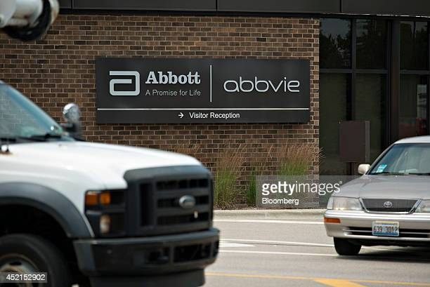 The logo for Abbott Laboratories hangs on a building at the company's headquarters complex in Abbott Park Illinois US on Monday July 14 2014 Abbott...