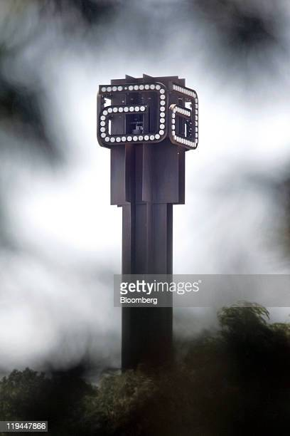 The logo for Abbott Laboratories sits atop a tower at the company's headquarters in Abbott Park, Illinois, U.S., on Wednesday, July 20, 2011. Abbott...