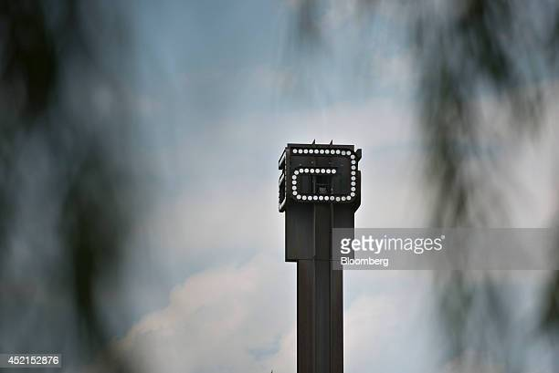 The logo for Abbott Laboratories sits atop a tower at the company's headquarters complex in Abbott Park Illinois US on Monday July 14 2014 Abbott...