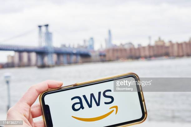 The logo for Amazon Web Services Inc., a subsidiary of Amazon.com Inc., is displayed on an Apple Inc. IPhone in an arranged photograph taken in the...
