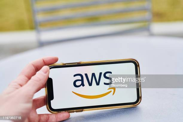 The logo for Amazon Web Services Inc a subsidiary of Amazoncom Inc is displayed on an Apple Inc iPhone in an arranged photograph taken in the...