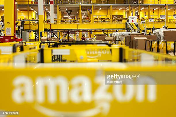 The logo for amazoncom inc sits on a cart parked in the inbound area at the Amazoncom Inc fulfillment center in Poznan Poland on Friday June 12 2014...