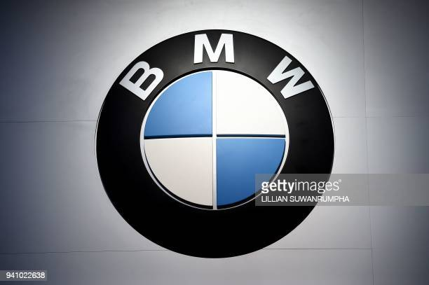 The logo for BMW is seen during the annual Bangkok International Motorshow in Bangkok on April 2 2018 / AFP PHOTO / LILLIAN SUWANRUMPHA