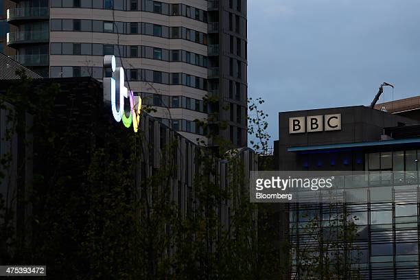 The logo for Independent Television and the British Broadcasting Corporation sit on top of buildings at MediaCityUK in Salford Quays Manchester on...