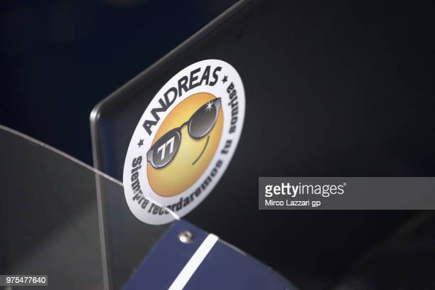 The logo for remeber the young CEV rider Andreas Perez of Spain and Reale Avintia Academy in box during the MotoGp of Catalunya Free Practice at...